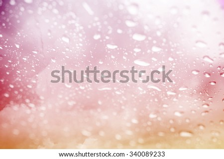 artistic soft cloud with blurred raindrop on gradient color - stock photo