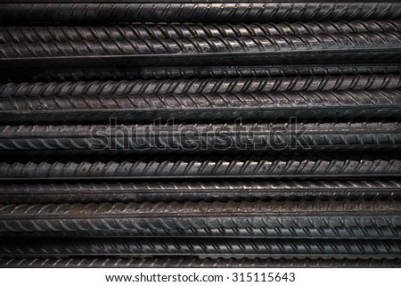 Artistic steel bars closeup, reinforcement on construction site, editable background. Steel bars or rods used on construction sites for concrete layering. - stock photo