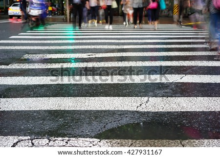 Artistic style - Crosswalk and pedestrian at modern city zebra crossing street in rainy day. Blur abstract.Background concept. - stock photo