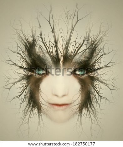 Artistic surreal portrait of a beautiful face of a young woman transformed in mysterious creature - stock photo