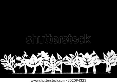 Artistic wooden trees and plants in a line - stock photo