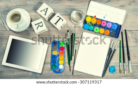 Artistic workplace mock up. Watercolor, brushes, paper, painting tools and items. Back to school concept. VIntage style toned picture - stock photo