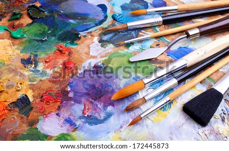 artists brushes and oil paints on wooden palette  - stock photo