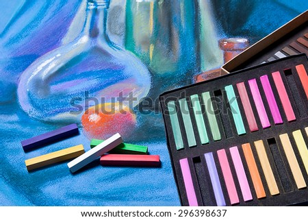 Artists chalk pastels and original pastel drawing of still life on the background. - stock photo