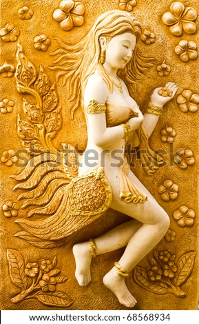 Arts and crafts plaster stucco wall natives in Thailand - stock photo