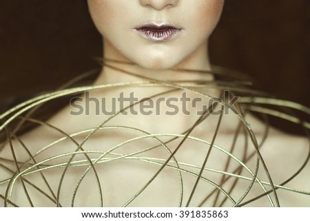 Arty beauty concept. Portrait of beautiful young woman with perfect healthy skin and avant-garde make-up. Retrofuturism style. Close up. Studio shot - stock photo