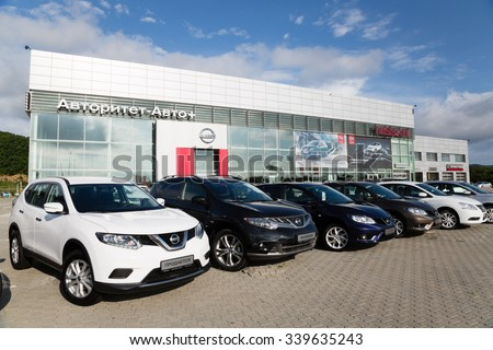ARTYOM, RUSSIA - CIRCA AUGUST, 2015: Cars at the dealership of Nissan for the city of Vladivostok. Nissan Motor Co., Ltd. - Japanese automaker, one of the largest in the world and the third in Japan. - stock photo