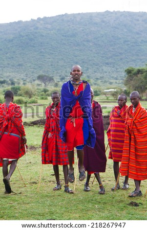 ARUSHA, TANZANIA - AUGUST 10: Masai men while jumping in a usual dance, masai people still live in the old way with traditional dress august 10, 2014 in Arusha, Tanzania - stock photo