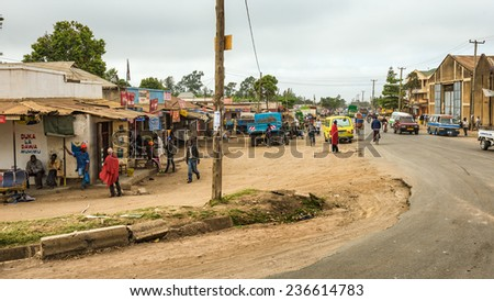 ARUSHA, TANZANIA - OCTOBER 21, 2014 : Typical street scene in Arusha. Arusha is located below Mount Meru in the eastern branch of the Great Rift Valley and the capital of the Arusha Region. - stock photo