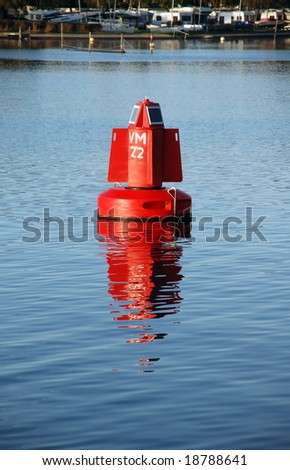 As a help with navigation floats a buoy the lake: it's working on a solar cell panel - stock photo