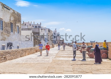 AS-SAWIRA, MOROCCO, APRIL 7, 2015: Local people and tourists walk on ramparts of Skala de la Ville - stock photo
