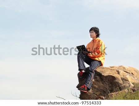 asain Man with notebook at day - stock photo