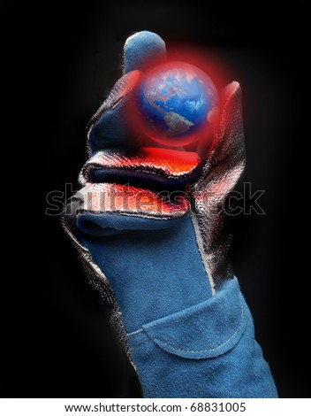 Asbestos gloved hand holds red hot model of earth with view of the Americas - stock photo