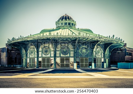 ASBURY PARK, NJ - SEPT. 21, 2013: Vintage carousel building on boardwalk on historic Asbury Park portrayed in retro tone. This now closed carousel house was designed by Warren Whitney. - stock photo