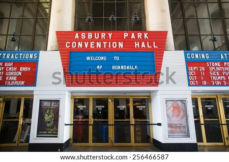 ASBURY PARK, NJ - SEPTEMBER 21, 2013:  Entrance and marquee at the historic Asbury Park Convention Hall on the boardwalk of the Jersey shore. - stock photo