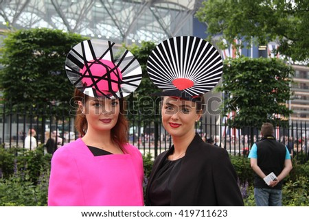 ASCOT - JUN 20, 2013: Racegoers attend day two of Royal Ascot at Ascot Racecourse on Jun 20, 2013 in Ascot - stock photo