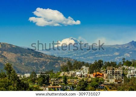 Ash cloud rising from Cotopaxi volcano, Ecuador, South America - stock photo