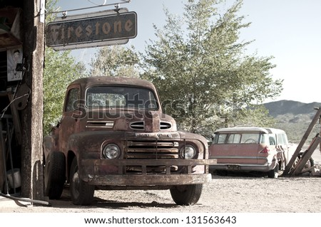 ASH FORK, USA - SEPTEMBER 25: rusty car wreck at a historic gas station at Route 66, vintage style, Ash Fork, Arizona, United States of America, sept 25 2011 - stock photo