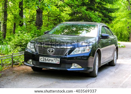 ASHA, RUSSIA - MAY 25, 2014: Motor car Toyota Camry in the city street. - stock photo