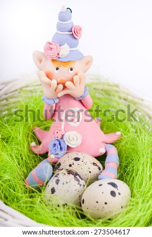ashamed fairy on the nest with quail eggs isolated on white background - stock photo