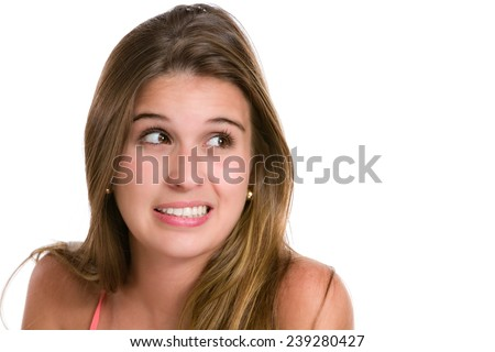 Ashamed or embarrassed Hispanic young woman. Image isolated on white with clipping path. - stock photo
