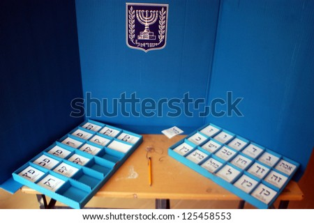 ASHDOD - FEBRUARY 10 2009:An Israeli voting booth in polling station during general election day. - stock photo