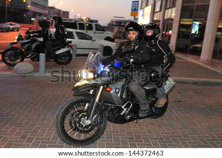 ASHDOD, ISR - JUNE 13:Wielding Yassam officers team on a Kawasaki KLE 500 motorcycle on June 13 2010.It's Israel Police special patrol unit dedicated for crowd control and special operations. - stock photo