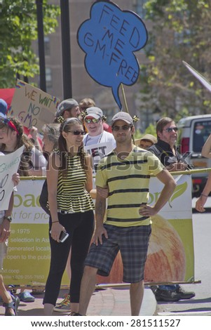 Asheville, North Carolina, USA - May 23, 2015: American grass roots activists protest Monsanto and its Genetically modified foods (GMOs) by wearing costumes and holding protest signs - stock photo