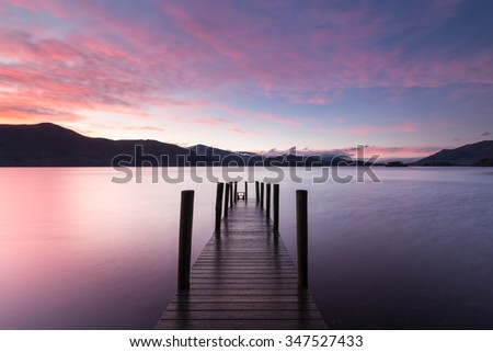 Ashiness Jetty on Derwentwater in the Uk Lake District at sunset - stock photo