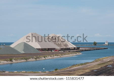 ASHTABULA, OH - SEPTEMBER 29: Massive pyramids of aggregate materials delivered by Great Lakes freighters in advance of cold weather line the harbor on September 29, 2012 at Ashtabula Ohio. - stock photo