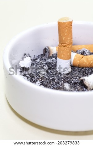 ashtray full of cigarettes close - up - stock photo