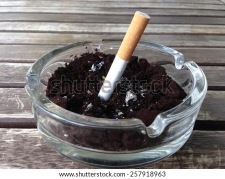 Ashtray with cigarette  - stock photo