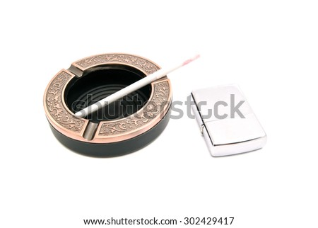 ashtray with cigarette and metal lighter closeup on white - stock photo