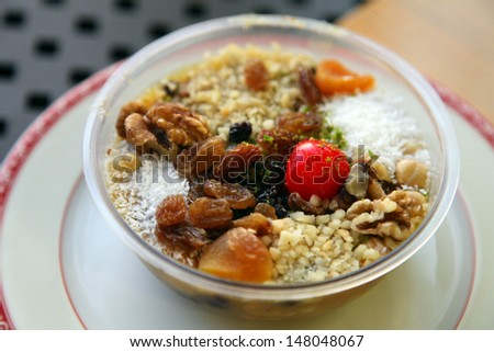 Ashura (Turkish name is Asure) at the restaurant table in Istanbul, Turkey. - stock photo