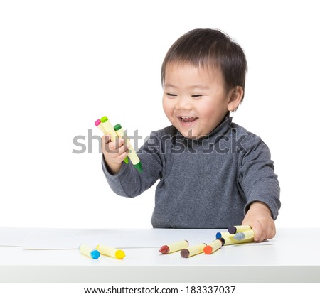 Asia baby boy play with crayon - stock photo