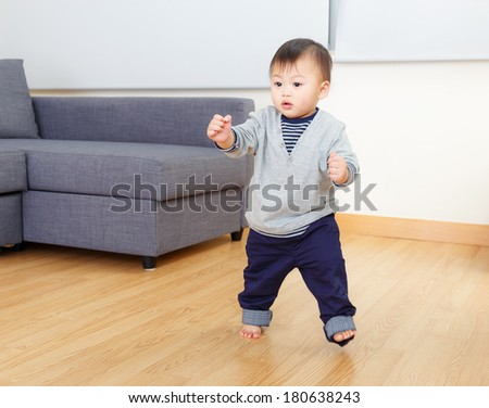 Asia baby boy try to walk at home - stock photo