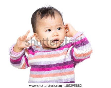 Asia baby girl touch her ear - stock photo