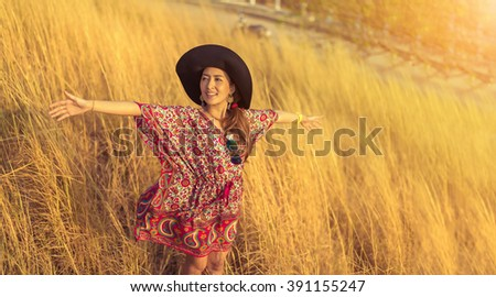 Asia beautiful Woman in Golden meadow. travel and sunset in vintage style - stock photo
