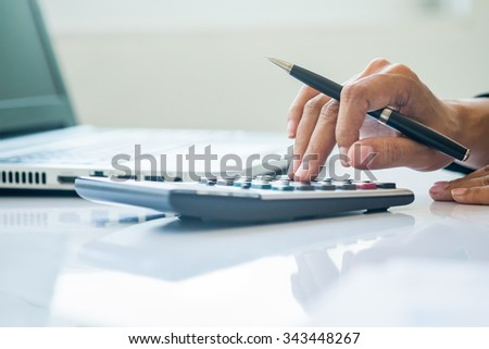 Asia business woman Analysis Business Accounting.(selective focus) - stock photo