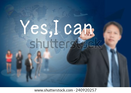 asia businessman writing, drawing yes i can on the screen.  - stock photo