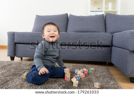 Asia little boy play wooden toy block - stock photo