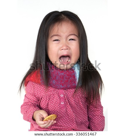 Asia little girl in sweater and scarves - stock photo