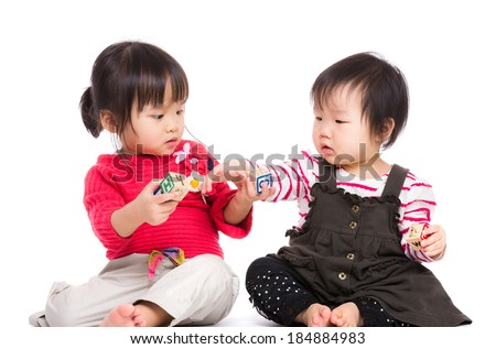 Asia sister play wodden toy block together - stock photo