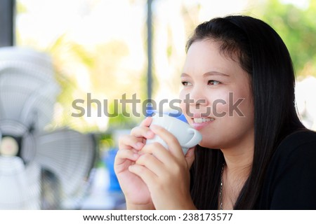Asia woman drink beverage at the restaurant. - stock photo