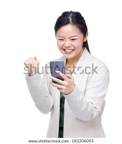 Asia woman feeling excited when reading message on mobile - stock photo