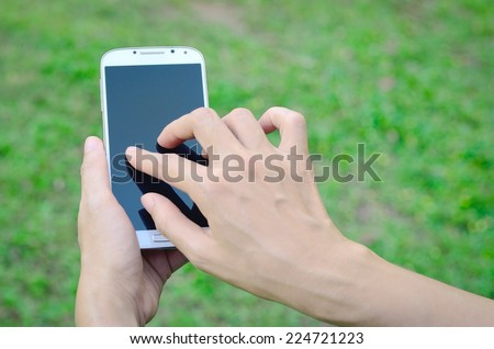 Asia woman hand holding and Touch on white Smartphone.  - stock photo