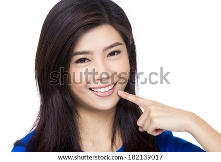 Asia woman pointing to her mouth and teeth - stock photo
