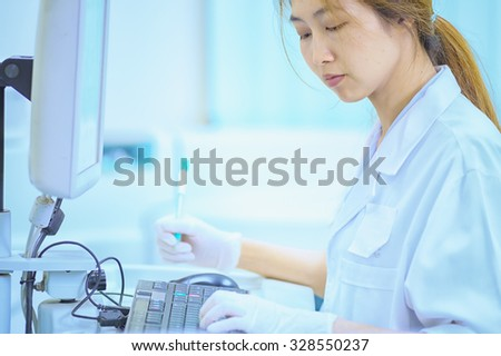 asia women working in laborytory at hospital - stock photo
