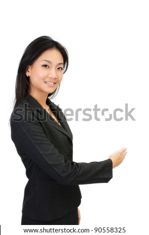 Asia young business woman making a welcoming gesture - stock photo