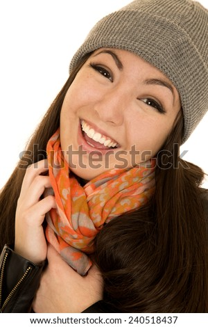 Asian American teen smiling wearing beanie and scarf - stock photo
